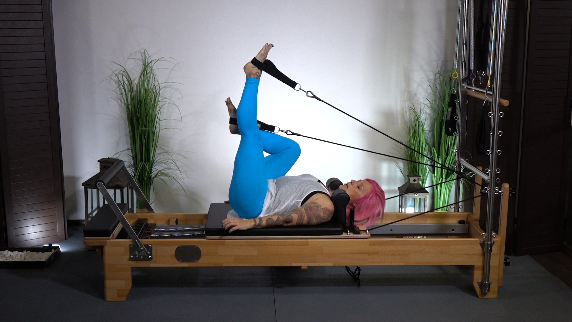Reformer tips - Legs on straps, a hip extension and excellent core balance exercise -Alpha Pilates